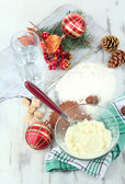 Cooking Christmas cookies on wooden table — Stock Photo