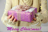 Female hands with gift box, close-up — Stock Photo