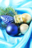 Beautiful Christmas decor on blue satin cloth — Stock Photo