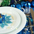 Small Christmas gift on plate on serving Christmas table in blue ton — Photo