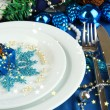Small Christmas gift on plate on serving Christmas table in blue ton — Stock Photo