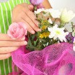 Florist makes flowers bouquet — Stock Photo #34636203