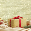 Beautiful bright gift and christmas decor, on shiny background — Stock Photo #34636217