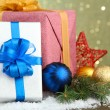 Beautiful bright gifts and christmas decor, on shiny background — 图库照片