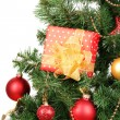 Stock Photo: Gift on Christmas tree isolated on white