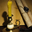 Old candle on table in room — Stock Photo
