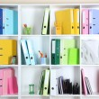 White office shelves with folders and different stationery, close up — Stock Photo #34636735