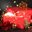 Gift box with bright light on it on dark grey background — Foto Stock