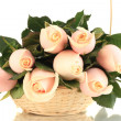 Stock Photo: Beautiful bouquet of roses in basket, isolated on white