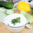 Cucumber yogurt in glass bowl, on color napkin, on wooden background — 图库照片