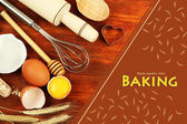 Cooking concept. Basic baking ingredients and kitchen tools on wooden table — 图库照片