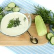 Cucumber yogurt in glass bowl, on color napkin, isolated on white — 图库照片