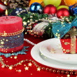 Stock Photo: Serving Christmas table on white and red fabric background close-up