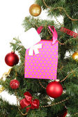 Gift on Christmas tree isolated on white — Stock Photo