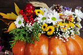 Beautiful autumn composition in pumpkin on wooden background — Stock Photo