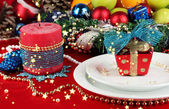 Serving Christmas table on white and red fabric background close-up — Stock Photo