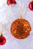 Christmas toys on snow-white Christmas tree isolated on white — Stock Photo