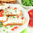 Sandwiches with cottage cheese and greens on plate isolated on white — Stock Photo #34831629