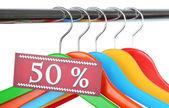 Houten kleerhangers als verkoop symbool geïsoleerd op wit — Stockfoto