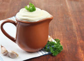 Sour cream in pitcher on table close-up — Stock Photo