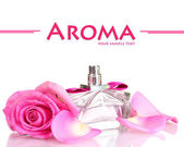 Perfume and pink roses isolated on white — Stock Photo