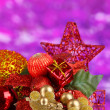 Composition of Christmas balls on purple background — Stok fotoğraf