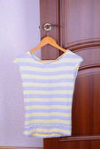 T-shirt hanging on door — Stock Photo