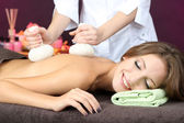 Beautiful young woman having back massage close up on color background — Stock Photo
