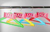 Wooden clothes hangers as sale symbol — Foto Stock