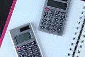 Calculators on notebook — Stock Photo