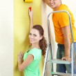 Young couple doing renovation in new house — Stock Photo