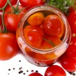 Stock Photo: Open glass jar of tasty canned tomatoes, isolated on white