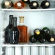 Refrigerator full of bottles with alcoholic drinks — Stock Photo