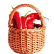 Red hot chili peppers in wicker basket,on sackcloth, isolated on white — Stock Photo #34992753