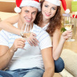 Young couple celebrating New Year — Stock Photo #34994659