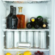 Refrigerator full of bottles with alcoholic drinks — Stock Photo #34996465