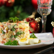 Постер, плакат: Russian traditional salad Olivier on wooden table on bright background