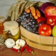 Composition of different fruit and vegetables on table on wooden background — Zdjęcie stockowe