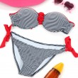 Swimsuit and beach items isolated on white — Stock Photo #34999961