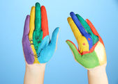 Painted hands with smile on blue background — Stock Photo