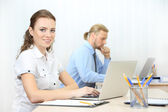 Woman in office workplace — Stock Photo