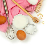 Cooking concept. Basic baking ingredients and kitchen tools isolated on white — Stock Photo