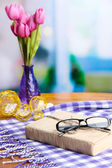 Old book, eye glasses, flowers and plaid — Stock Photo