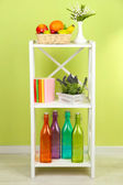 Composition of various home furnishing on white shelf — Stock Photo