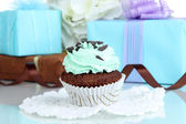 Tasty cupcake with gifts — Stock Photo