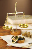 Wooden stamp, scales of justice and old papers on wooden table — Zdjęcie stockowe