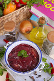 Raw liver in pan with spices and condiments on wooden table close-up — Stock Photo