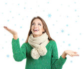 Beautiful smiling girl in warm knit scarf isolated on white — Stok fotoğraf