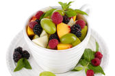 Fruit salad in cup isolated on white — Stock Photo