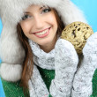 Beautiful smiling girl with Christmas ball on blue background — Stock Photo #35001507